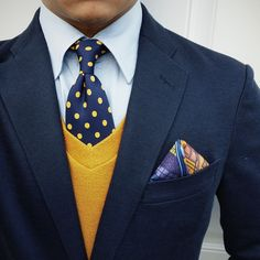 5 menswear influencers style our Polka Dot Tie in Navy + Lemon. Who wears it best. Cast your vote on our blog!