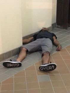 Friend passed out in apartment lobby. His shoes sum it up best.