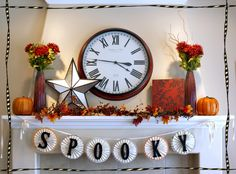 Beautiful fall/halloween mantle with banner