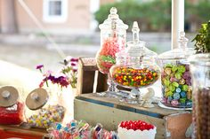 I love the single color candy buffets, but part of me loves the fun factor of having all the fun traditional colors of the candy...  It's what makes them recognizable...