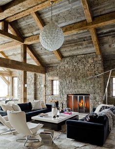 sofas flanking a fireplace . http://www.onekindesign.com/2012/03/02/rustic-modern-ski-house-in-big-sky/