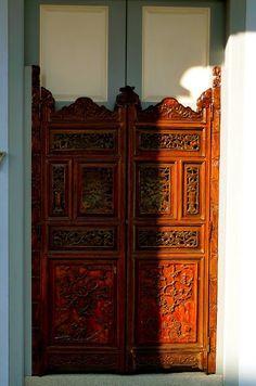 Intricately carved doors via Good Home Ideas: Peranakan Houses