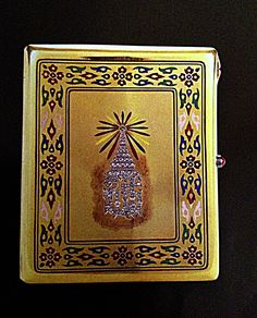 Gold cigarette multi-colored enamel box embossed with the Royal insignia of a crown set with diamonds.