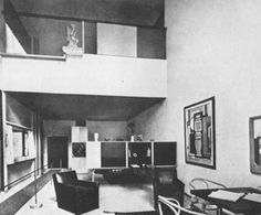 This image is full of 90 degree angles and looks very retro/modern. The use of line in almost every aspect of the room looks very clean. Though the space is open, and while still looking spacious, the futniture in the room is the same with the lines and shape. All very square-ish.