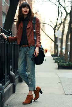 Natalie Suarez (blogger): sheer blouse + boyfriend jeans + folded jeans + suede motorbike jacket + ankle boots: street style, fall outfit, layering