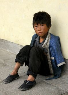 Early in the morning of a rainy day - homeless child in the streets of Hamhung, North Korea's second city