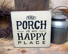 """This wooden sign reads """"The Porch Is My Happy Place"""" It measures 11 1/4"""" X 11 1/4"""" Hand painted a Beeswax Yellow with black lettering, sanded, stained and sealed to last for years. We use only local p"""