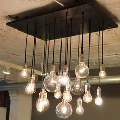 Hanging lights could look good to replace the chandelier in the dining room. Adds an industrial look - would have to see if it can match with the rest of the room.