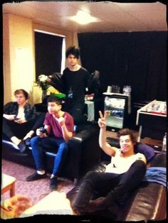 Harry with the 5 seconds of summer lads :)
