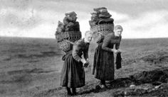 Old photograph of Crofters carrying Peat on the Isle Of Skye, Scotland