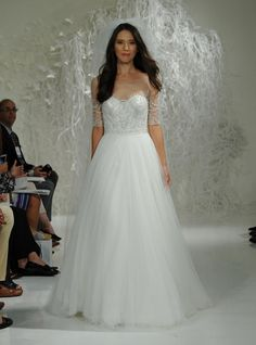 Watters Fall 2016 illusion neckline wedding dress with crystal beaded three quarter-length sleeves | https://www.theknot.com/content/watters-wedding-dresses-bridal-fashion-week-fall-2016