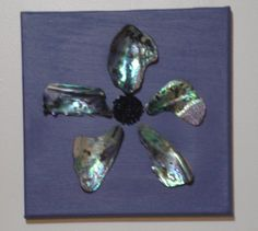 Paua Flower Picture.  Made on painted canvas with black seed beads and large paua pieces, simple and very effective