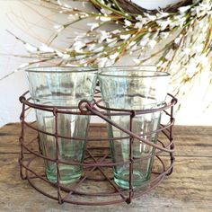 "This vintage inspired, round wire caddy features a rounded handle at top and four 6-oz recycled glass glasses. Perfect for serving drinks at your next party or picnic. Measures 7½"" dia. and ..."