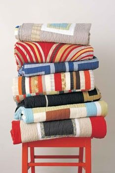 stack of quilts for cooler weather