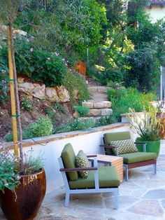 A path leads up the hillside to fruit trees and private meditation areas.