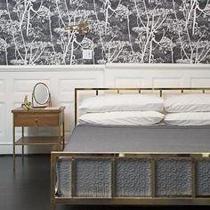 Sleek brass frame by Barcelona-based Mermelada Estudio dreams up a modern interpretation of a vintage bed. Spare, linear design aligns brass-plated iron rods from head to footboard on a low profile frame. Photo by @annawonderland_