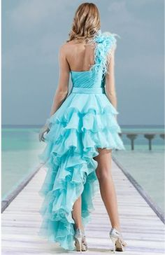 Love everything about his dress...the color, the hi-low, the ruffle...hopefully the front has some sparkles!! :)