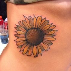 A sunflower is of course a classic choice for any '90s girl. Especially ones with Blossom Russo obsessions. | 31 Super Cute Tattoos For '90s Girls