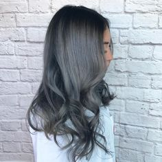 Dark grey hair with black roots