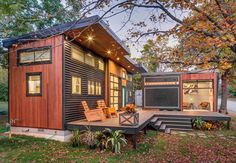 10 Tiny Houses We Love - Photo 7 of 10 - This sleek and modern L-shaped house consists of two separate structures that are joined by a deck. The 400-square-foot main house, which rests on a solid foundation, includes a kitchen, living room, bathroom, and loft bedroom. To make the small area feel more spacious, it was designed with high ceilings, lots of windows, and two custom garage doors to let in more light.