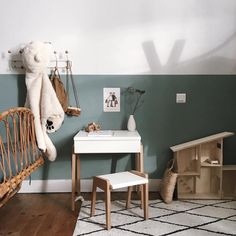 Half painted bedroom with a wonderful rattan bed, ferm living doll house and unique kids furniture