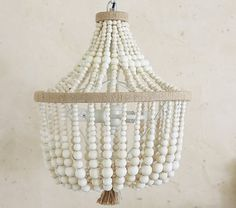 Pottery Barn Kids Dahlia Chandelier | http://www.potterybarnkids.com/products/wood-beaded-chandelier/?pkey=cchandeliers&bnrid=3517500&cm_ven=AfCmtyCont&cm_cat=rewardStyle&cm_pla=CJ&cm_ite=Std