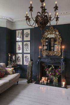 charming glam boho - black walls with white painted floor boards with gothic glam accents including an ornate gold mirror