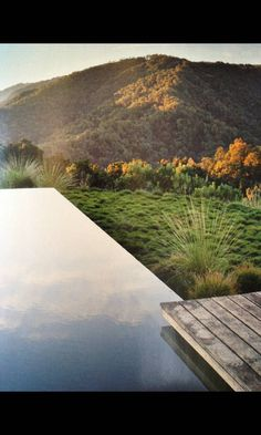 Infinity edge pool with wood deck cantilevered over it.  From Dwell ~6 months back.