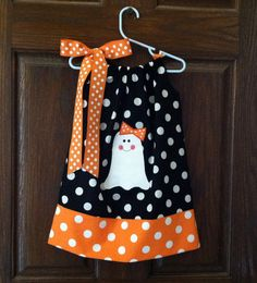 Halloween Dress...LOVE THIS!  I just bought fabric to make Claire & Libby a fall dress....something with candy corn.  This makes me think I will have to add a cute little girl ghost with a hairbow!