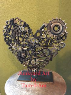 Junkyard Art by Tam-I-Am. A tabletop heart sculpture made from a bucket of scrap metal.  Scrap metal art.  Repurposed metal.