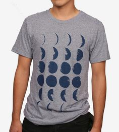 This t-shirt ode to the mysterious moon features all of its phases during a full lunar cycle, from waxing crescent to full moon and back to the new moon. Every phase is printed in navy ink on a soft heather grey tee, to wear and ponder any day of the month.