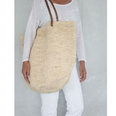 The classic beach tote puts the perfect finishing touch on endless looks, with brown leather straps for easy carrying. This stylish Summer bag offers plenty of space for the essentials, with a fully lined interior that features a pocket. Closure by a strong magnet. 100% Handmade and painstakingly Hand Woven using a strong yet subtle kind of straw. The straps are made of real leather and have a soft feel. Approx Size: Length 14.5 (37cm) Wide inch 21 (55cm) Handle Drop 10 inch (23cm) Please…