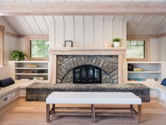 Modernized arts and crafts camp offers dreamy escape on Lake George #bedroom #fireplace #builtin #seat