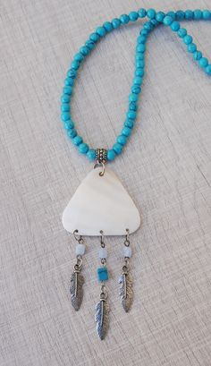 Turquoise beaded necklace with Mother of Pearl Shell pendant and Feather charms #turquoisenecklaces #feathernecklaces #turquoisejewelry #bohonecklaces #bohojewelry Turquoise Color, Turquoise Jewelry, Boho Jewelry, Handmade Jewelry, Summer Necklace, Boho Necklace, Pendant Necklace, Shell Pendant, Pearl Pendant