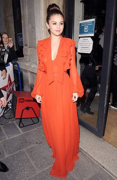 Selena Gomez in Giambattista Valli  Liking this 70s look (Gunne Sax, anyone?) but wish the bell sleeves were slightly less billowy...