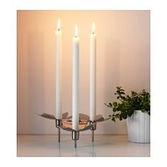 IKEA - STOCKHOLM, Candlestick for 3 candles, Creates atmosphere in the room with a design inspired by nature and the warm glow from the candles.Beautiful shadow patterns form on the table under the candlestick when the candlelight falls on the leaf-patterned metal.The candlestick has extra weight and stability because it's made of stainless steel.
