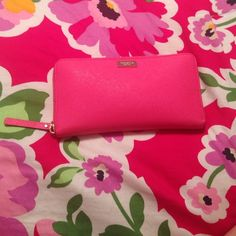 Kate Spade Hot Pink Zip Around Wallet!!! The only defects is the small smudge on the outer zip and the middle zip inside the wallet where I kept my change. Other than that it looks brand NEW! I have taken very good care of it! I hope you will love it too!!! kate spade Bags Wallets