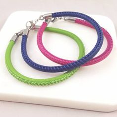 Whoop whoop!  We love a new colour!  Mojo bead bracelets now available in some stonking summer bright colours in addition to black, grey and red, we now have pink, navy and apple green.  Scrumptious!