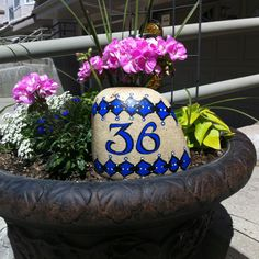 Rock painted with your house number.