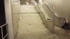 Berlin underground station has flooded after 'heaviest rain in a century'.