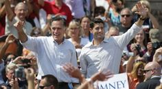 Republican presidential candidate, former Massachusetts Gov. Mitt Romney, left, and his vice presidential running mate, Rep. Paul Ryan, R-Wis., greet supporters during a campaign event at the Long Family Orchard Farm and Cider Mill in Commerce, Michigan., Friday, Aug. 24, 2012. - (AP Photo/Paul Sancya)