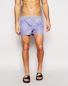 Swim shorts by Boardies Smooth, silky fabric Mesh lining Drawstring waistband Three pocket styling Regular fit - true to size Machine wash 100% Polyester