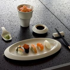 """With the """"Velvet"""" tableware from Hering Berlin, you automatically have more than just one dinner service. That is because the shapes of the many individual pieces of """"Velvet"""" can also serve as a practical sushi set. Stefanie Hering's dinner service is completely handmade from smoothly polished biscuit porcelain."""