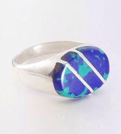 A personal favorite from my Etsy shop https://www.etsy.com/listing/463003119/vintage-azurite-mens-ring-signet-style