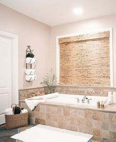 This casual comfortable bathroom utilizes chrome tub fixtures, tile tub surround, dark gray stone tile flooring and a drop in soaker tub for a relaxed feel. Bathtubs For Small Bathrooms, Best Bathtubs, Luxury Bathrooms, Master Bathrooms, Small Soaking Tub, White Kitchen Inspiration, Bathroom Inspiration, Tile Tub Surround, Drop In Tub