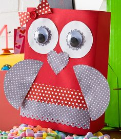 Make an owl Valentine holder out of a cereal box with modpodge