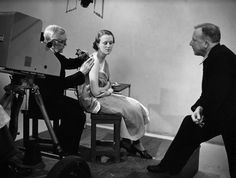 British George Burchett demonstrating tattooing in a UK series, host S.P.B. Mais is at right -- 1938.