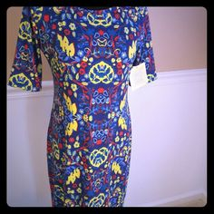 LuLaRoe Julia You won't believe how comforable Julia is! This soft, knee-length dress with high neck line sports bold coloring and designs, so just go with it and be bold! Jean jacket and leather boots for a casual look, or flats and necklace for dressy look, this versatile piece will be a favorite for sure! LuLaRoe Dresses Midi