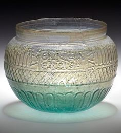 Glass bowl signed by Ennion. Blown in a four part mold. Roman, first half of 1st…