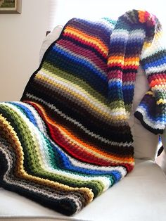 scrappy striped afghan- love all the colors in this one-slip stitch followed by a double crochet-repeat across, next row double crochet in the slip stitch and slip stitch in the double crochet.